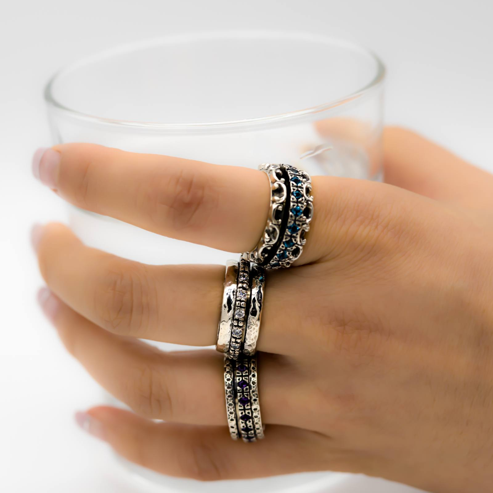 Meditation Spinner Rings holding Glasses